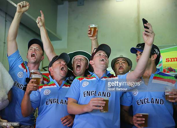 Barmy Army members celebrate after a wicket during day one of the First Ashes Test match between Australia and England at The Gabba on November 21...