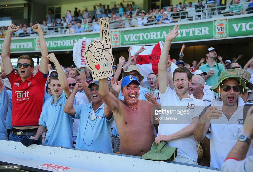 Barmy Army members celebrate after a wicket during day one of the First Ashes Test match between Australia and England at The Gabba on November 21, 2013 in Brisbane, Australia. The Barmy Army is a group of English cricket fans which arranges touring parties for some of its members to support the English cricket team on overseas tours, as well as followers of the team who join in with match day activities in the crowd, but do not travel as part of an organised tour.