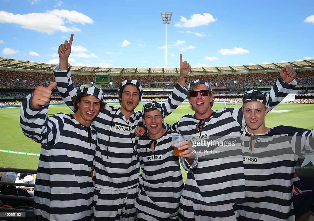 Barmy Army members dressed as convicts pose during day one of the First Ashes Test match between Australia and England at The Gabba on November 21, 2013 in Brisbane, Australia. The Barmy Army is a group of English cricket fans which arranges touring parties for some of its members to support the English cricket team on overseas tours, as well as followers of the team who join in with match day activities in the crowd, but do not travel as part of an organised tour.