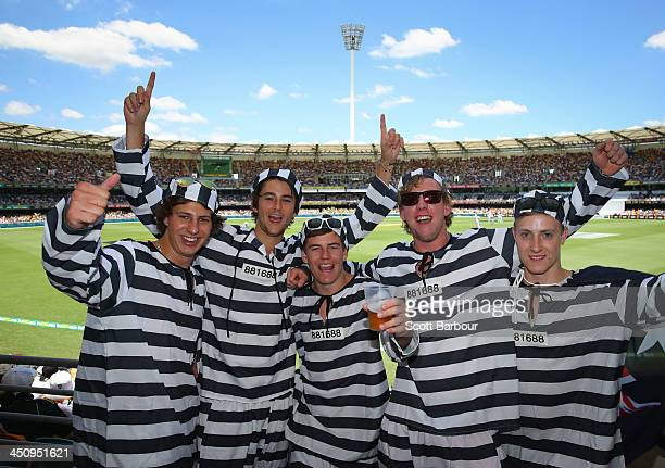 Barmy Army members dressed as convicts pose during day one of the First Ashes Test match between Australia and England at The Gabba on November 21...