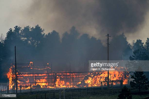 A barn is fully engulfed with flames allowing firefighters only the ability to watch and hope that it doesn't spread in the midst of the Black Forest...