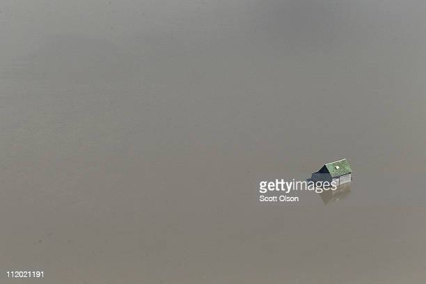 A barn is surrounded by floodwater from the Red River on April 11 2011 near Fargo North Dakota Although the Red River crested in Fargo on Saturday at...