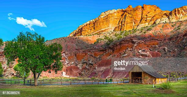 barn of the gifford homestead in capitol reef panorama - capitol reef national park stock pictures, royalty-free photos & images