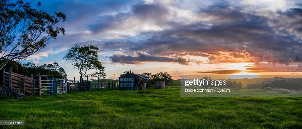 Barn On Field Against Sky During Sunset : Stock Photo