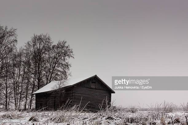 barn on field during winter against clear sky - heinovirta stock pictures, royalty-free photos & images
