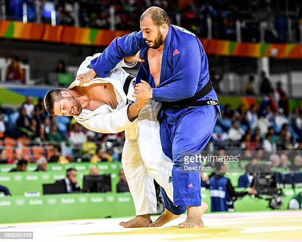 Barna Bor of Hungary attacks Faicel Jaballah of Tunisia in their o100kg contest that Bor won by ippon during day 7 of the 2016 Rio Olympic Judo on...