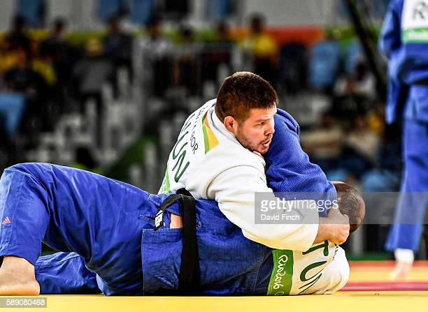 Barna Bor of Hungary holds Faicel Jaballah of Tunisia for 20 seconds to win their o100kg contest during day 7 of the 2016 Rio Olympic Judo on Friday...