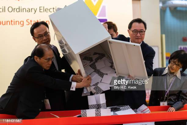 Barnabus Fung and Patrick Nip Takkuen empty a ballot box to count votes at a polling station on November 24 2019 in Hong Kong China Hong Kong held...