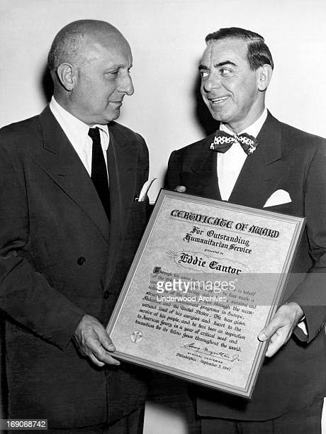 Barnaby Balaban president of Paramount Pictures presents comedian Eddie Cantor with the 1947 Award of the United Jewish Appeal for his humanitarian...