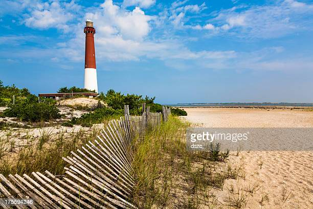barnegat lighthouse, sand, beach, dune fence, new jersey - new jersey stock pictures, royalty-free photos & images