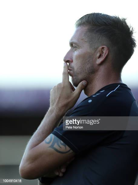 Barnet Assistant manager Darren Currie looks on during the PreSeason Friendly match between Northampton Town and Barnet at PTS Academy Stadium on...