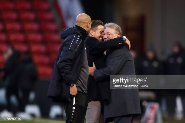 Barnet caretaker manager Darren Currie hugs Tony Currie at full time of the FA Cup Third Round match between Sheffield United and Barnet at Bramall...