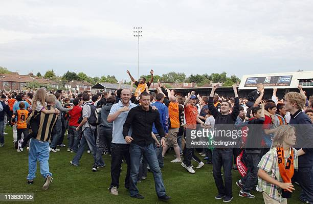Barnet fans celebrate after their team's victory ensures their league survival in the npower League Two match between Barnet and Port Vale at...