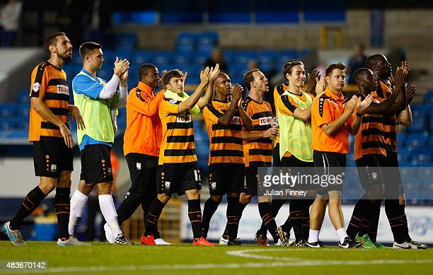 Barnet players celebrate defeating Millwall after extra time during the Capital One Cup First Round match between Millwall and Barnet at The Den on...