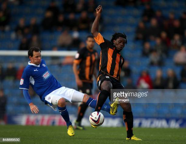 Barnet's Clovis Kamdjo is tackled by Chesterfield's Sam Togwell during the npower League Two match at the Proact Stadium Chesterfield