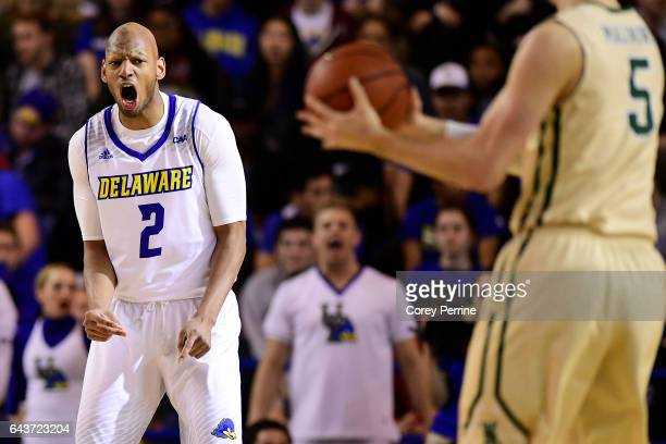 Barnett Harris of the Delaware Fightin Blue Hens reacts against Greg Malinowski of the William Mary Tribe during the first half at the Bob Carpenter...