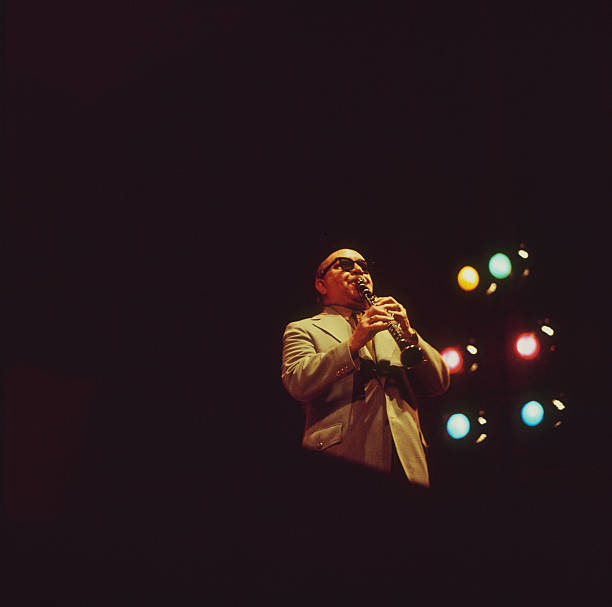 Barney Bigard performs on stage as part of the Newport...