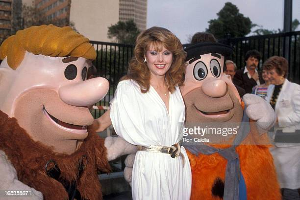 Barney Rubble actress Rebecca Holden and Fred Flintstone attend the NBC Television Affiliates Party on May 16 1983 at George C Page Museum La Brea...