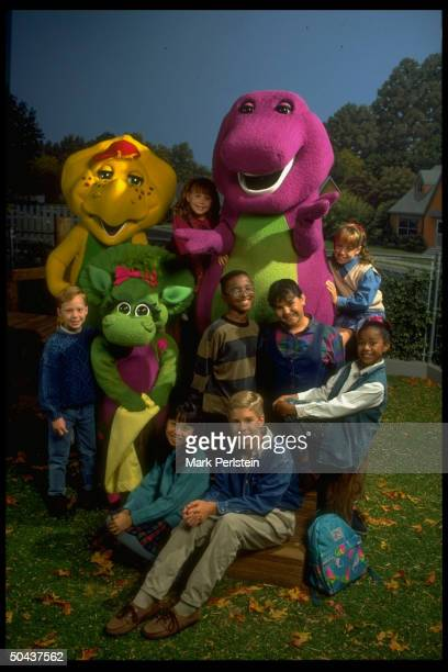Barney the purple dinosaur dominating scene fr PBS TV series Barney Friends