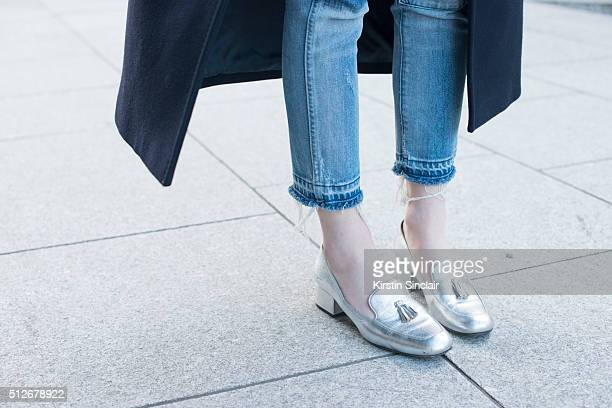 Barneys New York assistant fashion director Hannah Bibb wears Saint Laurent shoes on day 4 during London Fashion Week Autumn/Winter 2016/17 on...