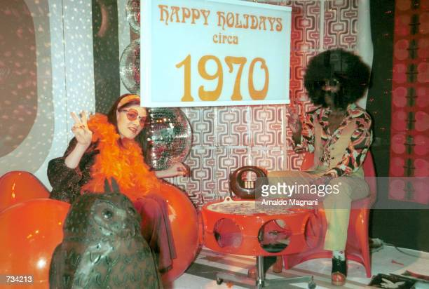 Barneys New York decorates a store window with holiday style from the 70's November 20 2000 on Madison Avenue in New York City Each window depicts...