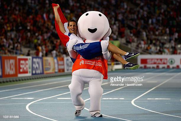Barni the mascot picks up Renaud Lavillenie of France after he won gold in the Mens Pole Vault Final during day five of the 20th European Athletics...