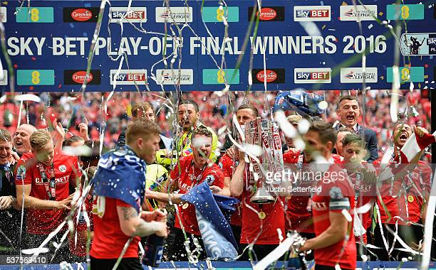 Barnsley celebrate winning the Sky Bet League One Play Off Final after beating Millwall at Wembley Stadium on May 29 2016 in London England