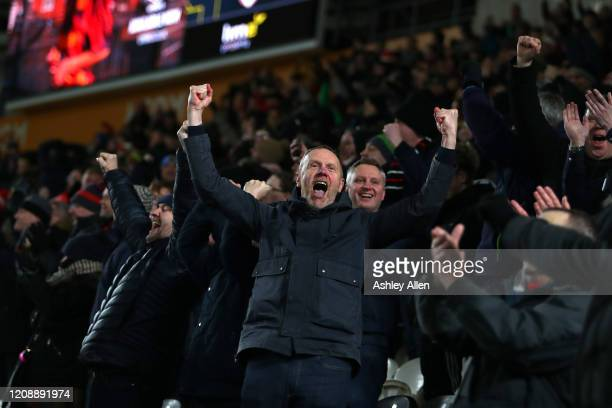 Barnsley FC fans celebrate their team's victory during the Sky Bet Championship match between Hull City and Barnsley at KCOM Stadium on February 26...