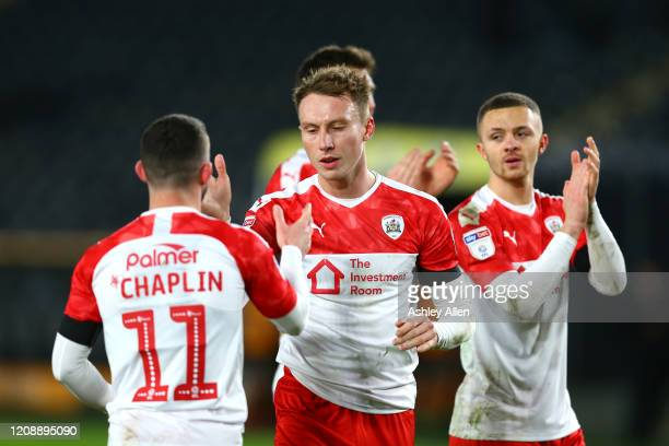 Barnsley FC players celebrate during the Sky Bet Championship match between Hull City and Barnsley at KCOM Stadium on February 26 2020 in Hull England