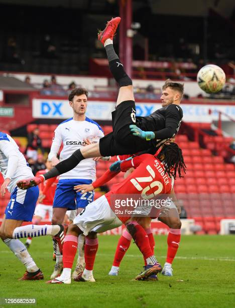 Barnsley goalkeeper Brad Collins goes airbourne at a corner during the FA Cup Third Round match between Barnsley and Tranmere Rovers at Oakwell on...