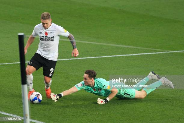 Barnsley goalkeeper Jack Walton dives to stop Martyn Waghorn of Derby during the Sky Bet Championship match between Derby County and Barnsley at...