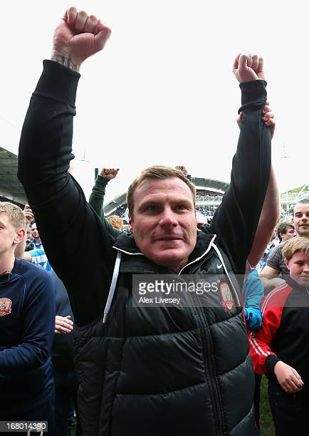 Barnsley manager David Flitcroft celebrates survival at the end of the npower Championship match between Huddersfield Town and Barnsley at John...