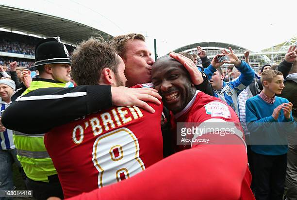 Barnsley manager David Flitcroft celebrates survival with Jim O'Brien and Jason Scotland at the end of the npower Championship match between...