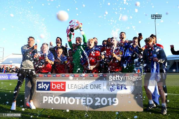 Barnsley players celebrate as their team are promoted following their result in the Sky Bet League One match between Bristol Rovers and Barnsley at...