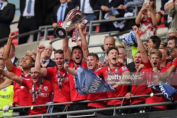 Barnsley players celebrate promotion after winning the Sky Bet League One Play Off Final between Barnsley and Millwall at Wembley Stadium on May 29...