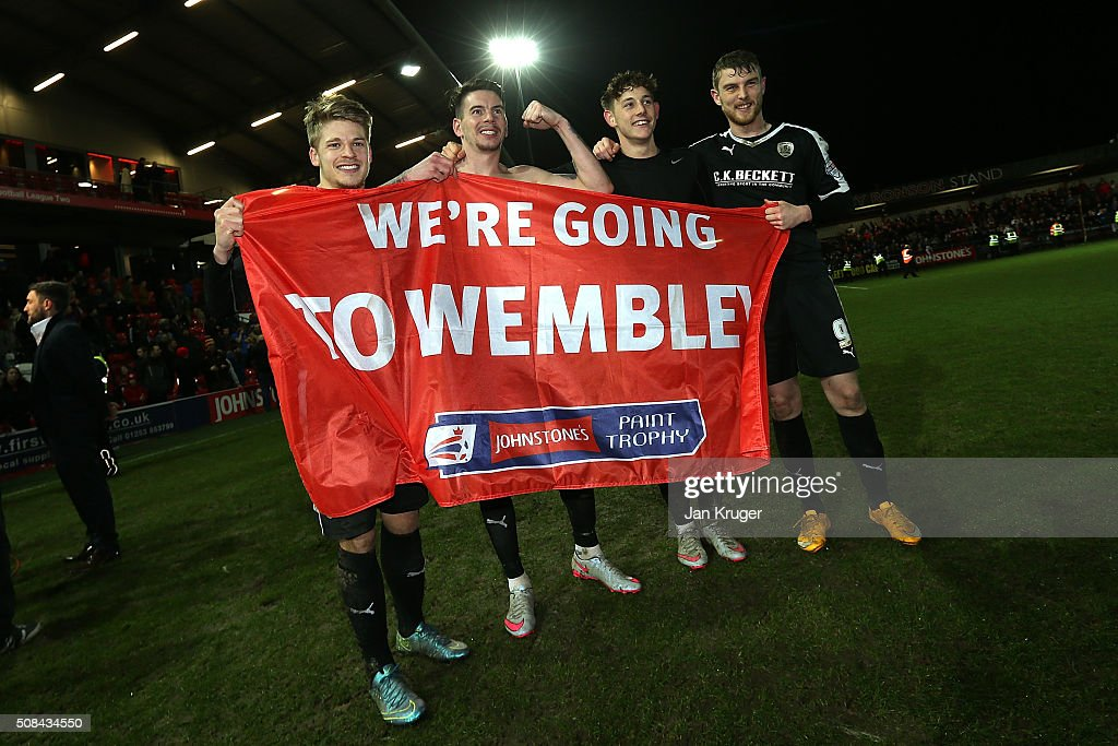 Barnsley players celebrate victory by posing with a flag during the Johnstone's Paint Trophy northern section semi final second leg match between Fleetwood Town and Barnsley at Highbury Stadium on February 4, 2016 in Fleetwood, England.