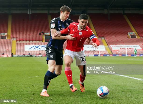 Barnsley's Alex Mowatt shields the ball from Middlesbrough's Paddy McNair during the Sky Bet Championship match between Barnsley and Middlesbrough at...