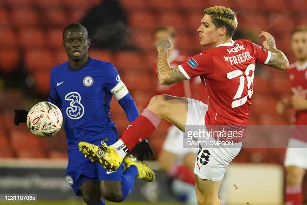 Barnsley's Austrian striker Dominik Frieser vies with Chelsea's French midfielder N'Golo Kante during the English FA Cup fifth round football match...