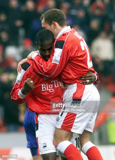Barnsley's Bruce Dyer celebrates scoring the opening goal against Gillingham with Alex Neil during the Nationwide Division One game at Oakwell Stadium