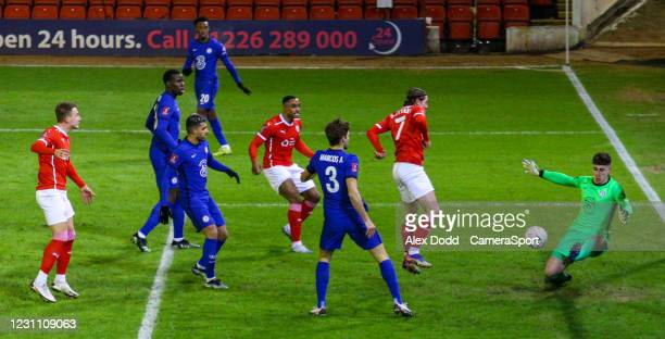 Barnsley's Callum Brittain sees his shot saved by Chelsea's Kepa Arrizabalaga during the Emirates FA Cup Fifth Round match between Barnsley and...