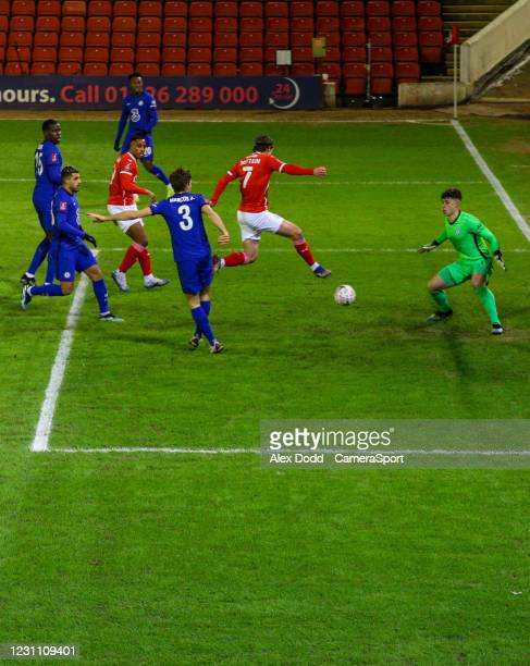 Barnsley's Callum Brittain shoots at close range during the Emirates FA Cup Fifth Round match between Barnsley and Chelsea at Oakwell Stadium on...