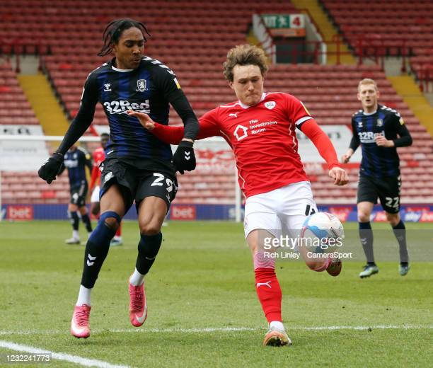 Barnsley's Callum Styles under pressure from Middlesbrough's Djed Spence during the Sky Bet Championship match between Barnsley and Middlesbrough at...