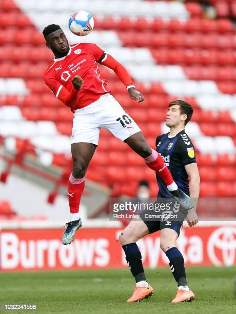 Barnsley's Daryl Dike wins a header despite the attentions of Middlesbrough's Paddy McNair during the Sky Bet Championship match between Barnsley and...