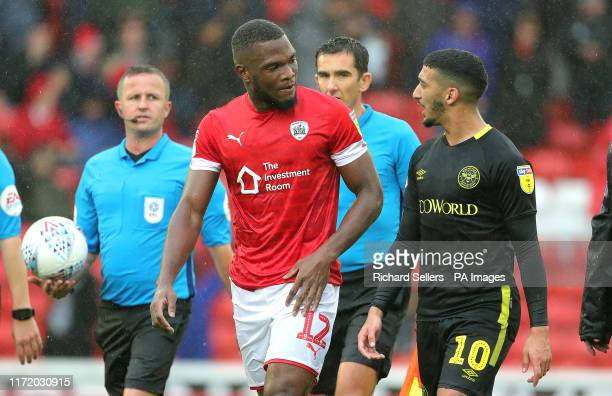 Barnsley's Dimitri Cavare and Brentford's Said Benrahma during the Sky Bet Championship match at Oakwell Barnsley