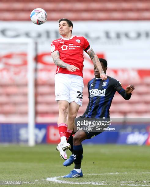 Barnsley's Dominik Frieser wins a header despite the attentions of Middlesbrough's Marc Bola during the Sky Bet Championship match between Barnsley...