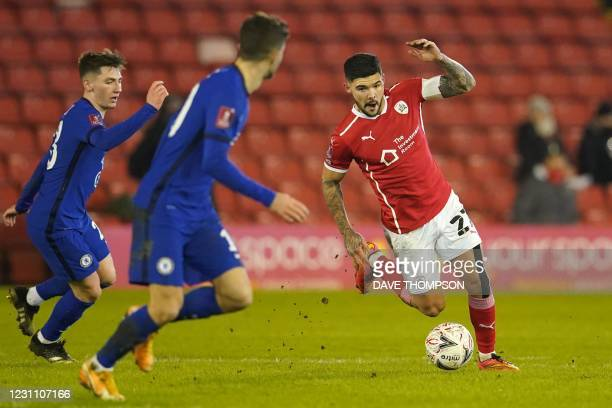 Barnsley's English midfielder Alex Mowatt runs with the ball during the English FA Cup fifth round football match between Barnsley and Chelsea at the...