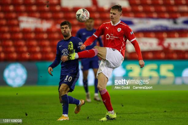 Barnsley's Mads Juel Andersen clears under pressure from Chelsea's Christian Pulisic during the Emirates FA Cup Fifth Round match between Barnsley...