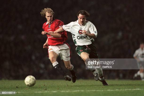 Barnsley's Matty Appleby clashes with Manchester United's Jordi Cruyff