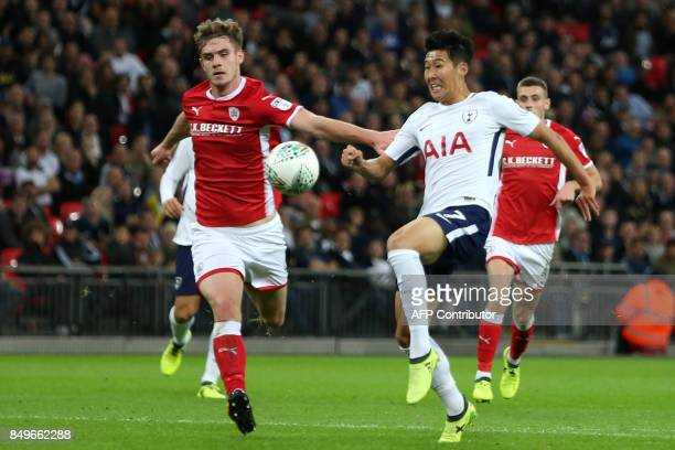 Barnsley's Scottish defender Liam Lindsay vies with Tottenham Hotspur's South Korean striker Son HeungMin during the English League Cup third round...