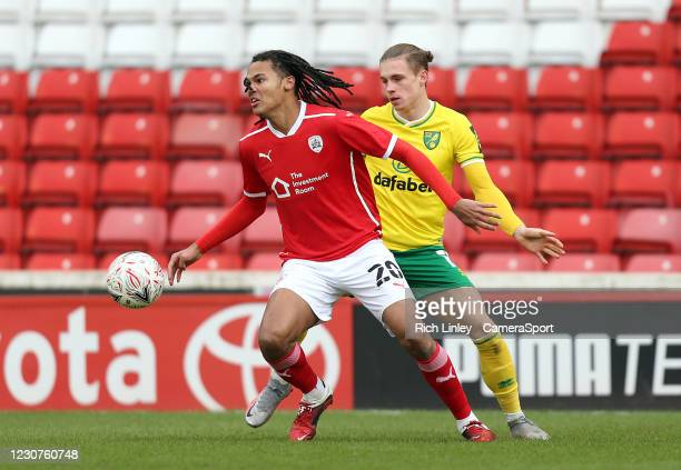 Barnsley's Toby Sibbick shields the ball from Norwich City's Przemyslaw Placheta during the The Emirates FA Cup Fourth Round match between Barnsley...